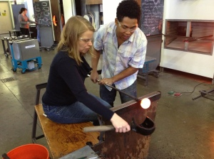 Here I'm shaping the paperweight - you'll notice that the instructor is doing most of the work